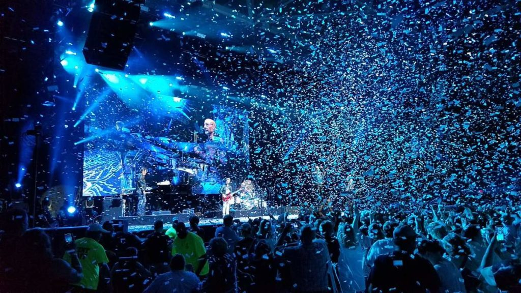 music concert with large crowd and confetti